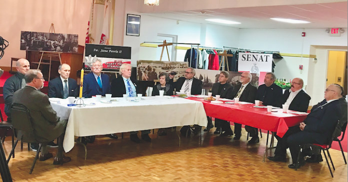 "The Symposium was prepared at the initiative of Jerzy Polak – Chairman of the Club ""Gazeta Polska"" in Stamford – and the Patriotic Forum in Stamford in cooperation with the Committee of Celebrations of the Anniversary of the Smolensk Disaster and the Katyn Genocide, the Foundation The Clubs of the ""Polish Newspaper"" in the United States, the Reduta of the Good Name – USA, the Families of Radio Maryja and the Clubs ""Gazeta Polska"" from the east coast of the United States (NY, NJ, Boston, Philadelphia and Florida)."